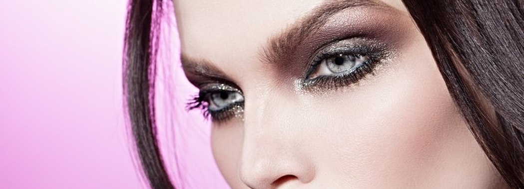 beautiful girl with smoky eyes on the pink background